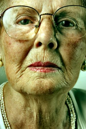 aging skin: closeup of senior woman face