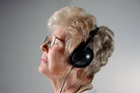 senior lady on profile with headphones