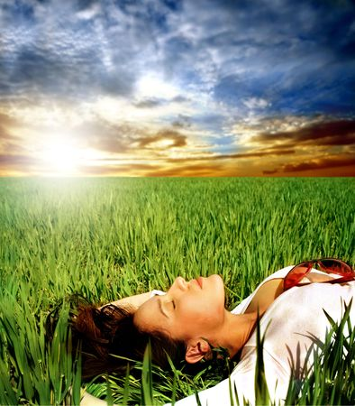attractive woman lying down on grass photo