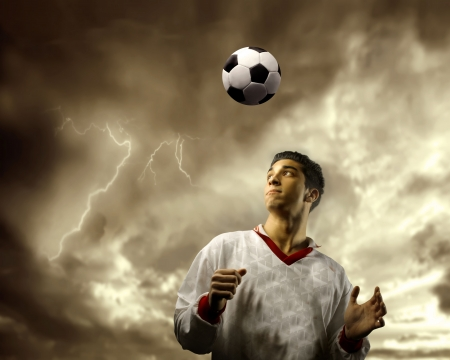 bad condition: soccer or football  player against a stormy sky