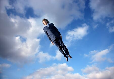 flying man: business man flying in the sky