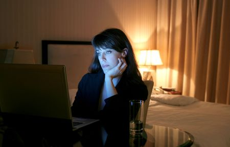 business woman  using laptop in a hotel room photo