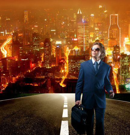 future earnings: businessman walking on a city street