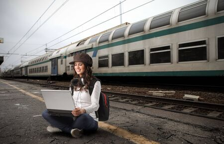 girl with laptop in a station