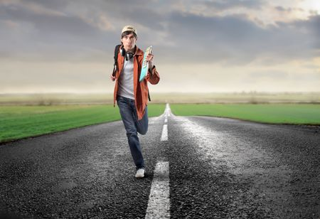 ways to go: Young man running on a countryside road