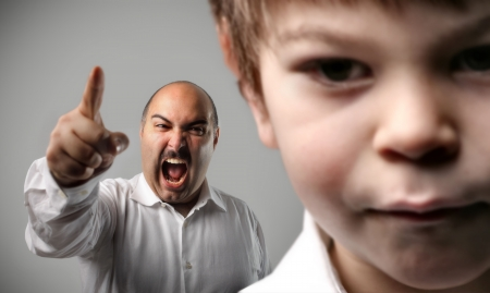 argues: Sad child and shouting adult on the background