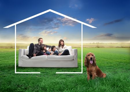 green couch: Smiling family sitting on a sofa surrounded by the form of a house with a dog netx to them