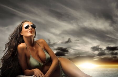 sexy beach girl: Beautiful woman in swimsuit and sunglasses  Stock Photo