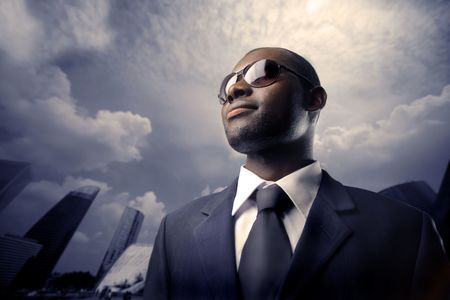 African businessman with sunglasses photo