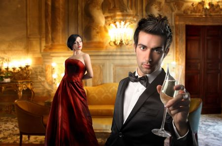 riches: Young couple in a luxury hotel Stock Photo