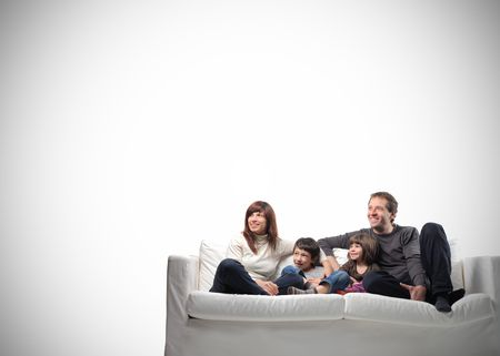 Smiling family sitting on a couch