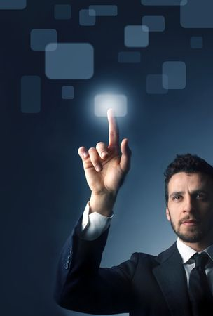business opportunity: Businessman pressing  a button of a touchpad Stock Photo