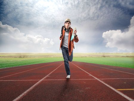 student book: Student running on a running track