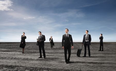 Group of business people standing on a field Stock Photo - 6769628