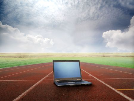 running on track: Laptop lying on a running track