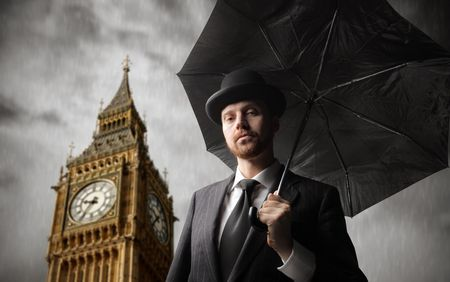 british  english: Gentleman with umbrella and Big Ben on the background