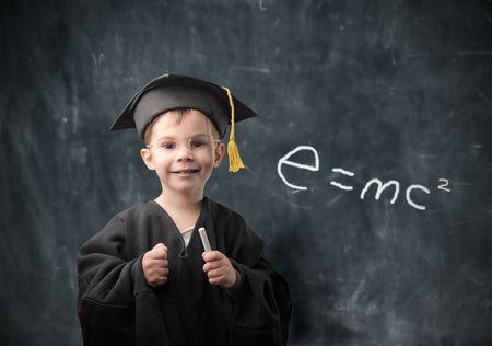 Smiling child in graduate uniform Stock Photo - 6769631