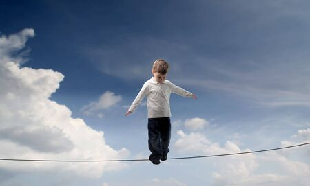 Child standing in balance on a rope Stock Photo - 6769629