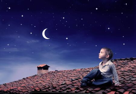 stars sky: Child sitting on a rooftop and looking at the moon