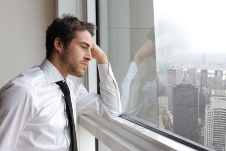 Businessman looking out of a window photo