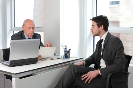 advancement: Young businessman in an interview with senior manager Stock Photo