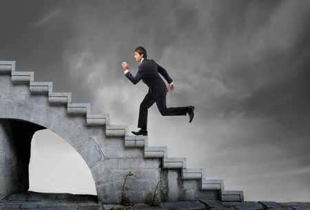 steps to success: Businessman running on a stairway