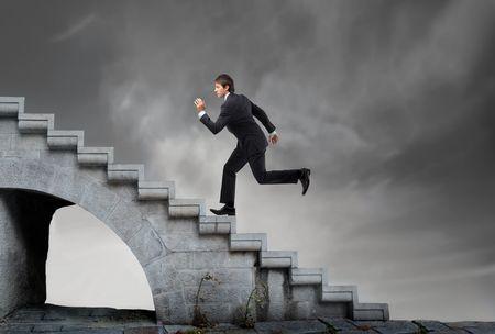 Businessman running on a stairway