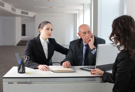 Young businesswoman in an interview with two managers photo