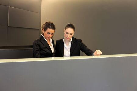 hotel worker: Two pretty receptionists Stock Photo