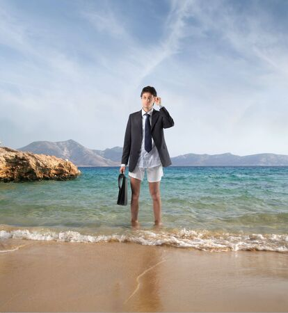 Businessman in jacket and underpants at the seaside photo