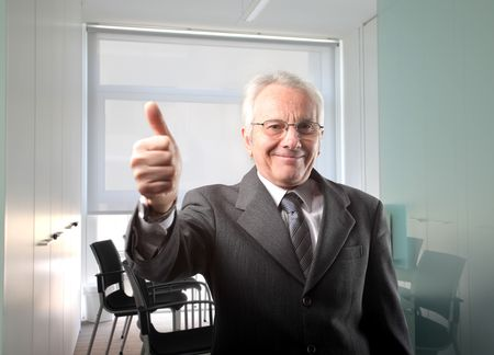 Senior businessman with thumbs up Stock Photo - 6898951