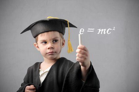 Child writing a physics formula Stock Photo - 6898957