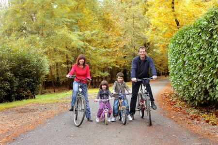 healthy path: Happy family riding bicycles Stock Photo
