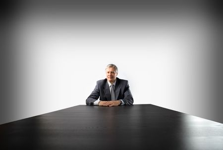 Senior businessman sitting at a table