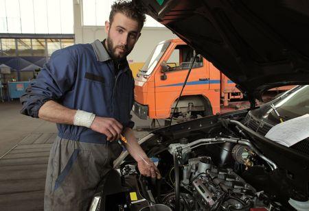 mechanician: Mechanician standing in front of a car Stock Photo