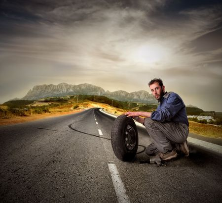mechanician: Mechanician holding a car tire