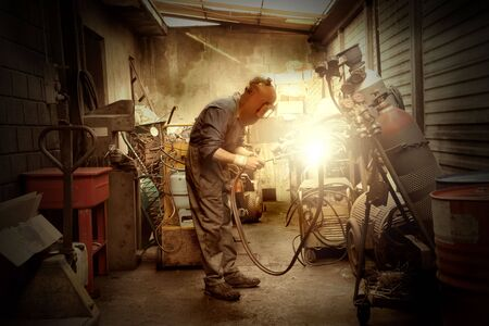 blowtorch: Worker using a blowtorch Stock Photo