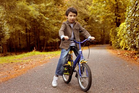 Child learning how to ride a bicycle photo