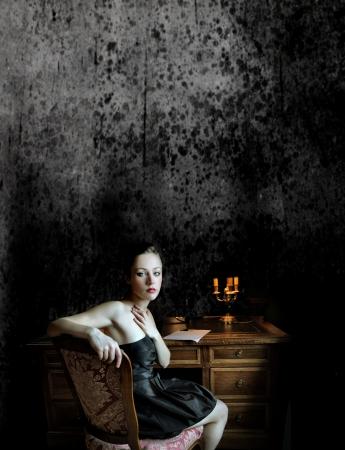 Beautiful woman sitting at a desk and reflecting Stock Photo - 6960748