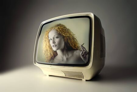 appearing: Woman appearing on television Stock Photo