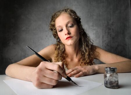 writing letter: Beautiful woman writing a letter