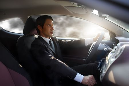 Businessman driving a car photo