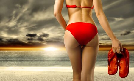 sandal: Detail of a beautiful womans body wearing a red swimsuit