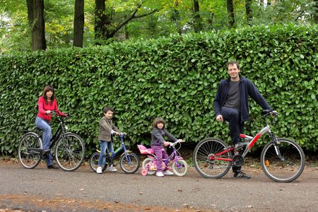 healthy path: Family riding bicycles in a park