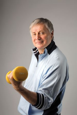 Senior man lifting a weight photo