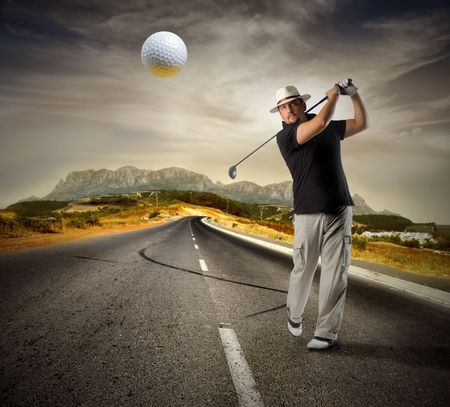 street shot: Man playiong golf on a countryside road