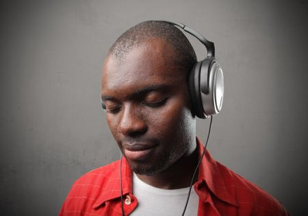 Smiling black man listening to music photo