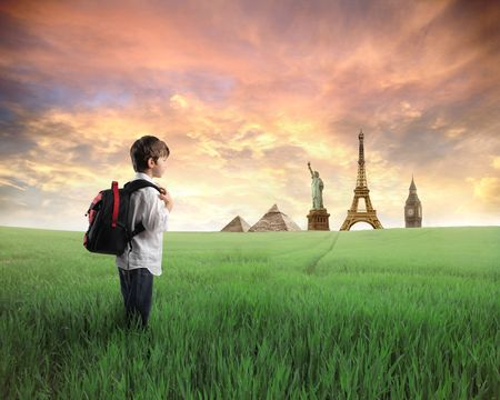 batoh: Child with rucksack standing on a green meadow with landmarks of diverse countries on the background