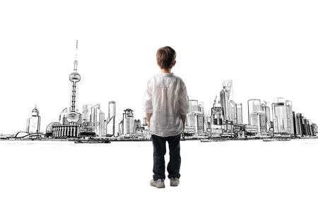 back view: Child observing a cityscape
