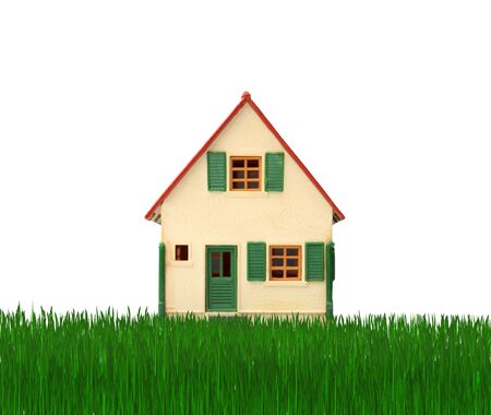 mortage: Model of a house on a green lawn Stock Photo